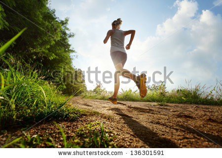 stock-photo-young-lady-running-on-a-rural-road-during-sunset-136301591